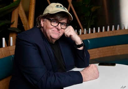 "Michael Moore, director of the new documentary film ""Fahrenheit 11/9,"" poses for a portrait at the Endeavor Lounge during the Toronto Film Festival, Sept. 7, 2018, in Toronto."