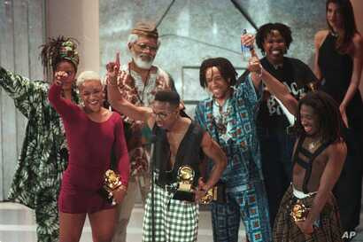FILE - Members of the band Arrested Development accept their Grammy award at the award show in Los Angeles, Feb. 24, 1993.