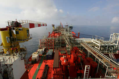 FILE - The deck of Bluewater's floating production, storage and offloading vessel Munin, which floats on the Lufeng oil field, 250 kilometers south-east of Hong Kong in the South China Sea.