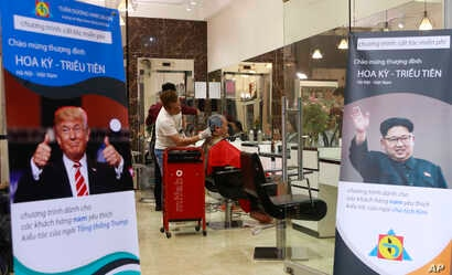 Signs depicting U.S. President Donald Trump and North Korean leader Kim Jong Un are displayed in a barbershop in Hanoi, Vietnam, Feb. 19, 2019. The two leaders have become style icons ahead of their upcoming summit in Hanoi.