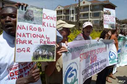 FILE - Demonstrators protest the route of Standard Gauge Railway (SGR) being built by Chinese government, which is to cut through the middle of the Nairobi National Park, at a rally outside the People's Republic of China Embassy in Nairobi, Oct. 17, ...