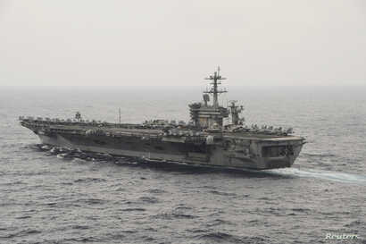 The aircraft carrier USS Theodore Roosevelt (CVN 71) transits the South China Sea in this U.S. Navy picture taken Oct. 29, 2015. U.S. Secretary of Defense Ash Carter will visit the Roosevelt as it transits the South China Sea on Thursday.