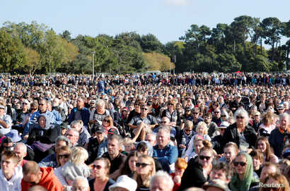 People attend the national remembrance service for victims of the mosque attacks, at Hagley Park in Christchurch, New Zealand, March 29, 2019.