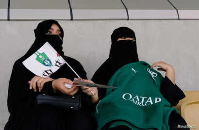 Saudi women watch the soccer match between Al-Ahli against Al-Batin at the King Abdullah Sports City in Jeddah, Saudi Arabia, Jan. 12, 2018.