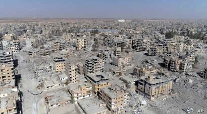 This Oct. 19, 2017 frame grab made from drone video shows damaged buildings in Raqqa, Syria, two days after Syrian Democratic Forces said that military operations to oust the Islamic State group have ended.