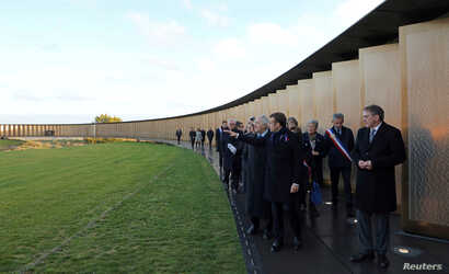 "French President Emmanuel Macron visits the ""Ring of Memory"" international World War I memorial, at the Notre Dame de Lorette French War Cemetery near Arras, France, Nov. 8, 2018."