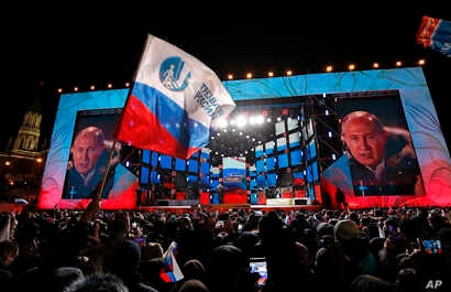 Russian President Vladimir Putin speaks to supporters during a rally near the Kremlin in Moscow, March 18, 2018.