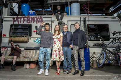 """In this March 16, 2018 photo, Tye Sheridan, from right, Steven Spielberg, Oliva Cooke, and Lena Waithe pose for a portrait at the interactive """"Ready Player One"""" pop-up on Hollywood and Vine in Los Angeles."""