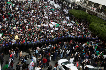 Students take part in a protest to denounce an offer by President Abdelaziz Bouteflika to run in elections next month but not to serve a full term if re-elected, in Algiers, Algeria, March 5, 2019.