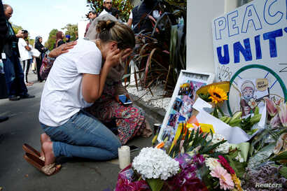 A woman reacts at a make shift memorial outside the Al-Noor mosque in Christchurch, New Zealand, March 23, 2019.