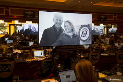 A television commercial promoting Vice President Joe Biden to run in the 2016 democratic presidential race is shown as reporters work in the press room at for the democratic debate at the Wynn Hotel in Las Vegas, Nevada October 13, 2015.