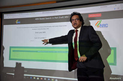 FILE - Prateek Hajela, Assam's chief co-coordinator of the National Register of Citizens (NRC), demonstrates how to check a name online on its website after the publication of the first draft of the NRC in Guwahati city in the northeastern state of A...