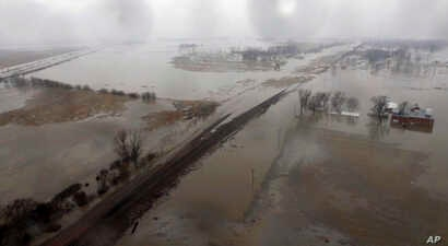 This aerial photo shows flooding along the Missouri River in Pacific Junction, Iowa, March 19, 2019. The U.S. Army Corps of Engineers says rivers breached at least a dozen levees in Nebraska, Iowa and Missouri. Hundreds of homes are damaged, and tens...