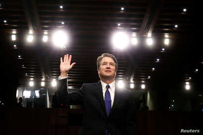 U.S. Supreme Court nominee judge Brett Kavanaugh is sworn in during a Senate Judiciary Committee confirmation hearing on Capitol Hill in Washington, Sept. 4, 2018.