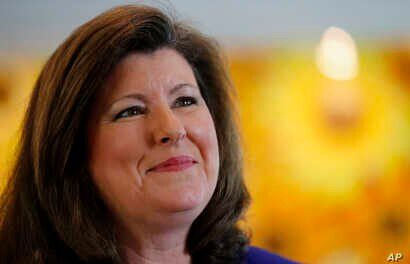 FILE - Republican Karen Handel speaks to a reporter in Roswell, Georgia, May 14, 2014.