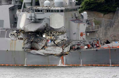 Damaged part of USS Fitzgerald is seen at the U.S. Naval base in Yokosuka, southwest of Tokyo, June 18, 2017.  Navy divers found a number of sailors' bodies Sunday aboard the stricken USS Fitzgerald that collided with a container ship in the busy sea...