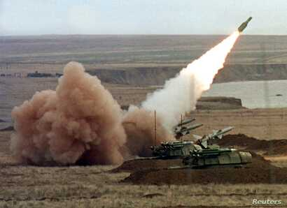 "A ""Buk"" anti-aircraft battery launches a ground-to-air missile during the Ukrainian army's ""Duel-99"" military maneuvers at the Chauda firing ground in the Crimean peninsula, October 12. The Russian air force said on Tuesday Moscow has agreed to allow..."