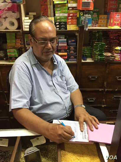 Suresh Kumar, who runs a mom-and-pop store in a New Delhi neighborhood market, is bewildered by the new tax. He does not know how to operate a computer and says employing someone to operate it will eat into his thin profit margins.