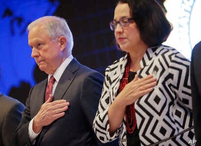 U.S. Attorney General Jeff Sessions and U.S. Ambassador to El Salvador Jean Elizabeth Manes stand during the playing of the U.S. national anthem during a graduation ceremony at the International Law Enforcement Academy in San Salvador, El Salvador, J...