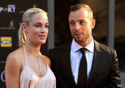 South African Olympic athlete Oscar Pistorius and Reeva Steenkamp at an awards ceremony, in Johannesburg, South Africa, Nov. 4, 2012.