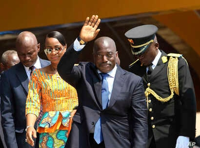 FILE - Congolese President Joseph Kabila, center, waves as he and others celebrate independence for the Democratic Republic of Congo in Kindu, Congo.