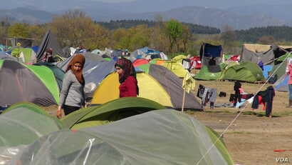 Winter rains destroyed many of refugees' tents, with some people falling ill from the cold temperatures. Travelers say if the refugees still here in the summer, the heat may be worse than the rains, in Idomeni, Greece, March 31, 2016.  (Photo - H. ...