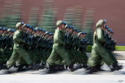 "FILE - Russian paratroopers march during the celebrations of Paratroopers Day in the Red Square in Moscow, Russia, Aug. 2, 2017. The Russian military says major war games, the Zapad (""West"") 2017 maneuvers, would include 13,000 Russian and Belarussia..."