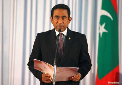 FILE - Abdulla Yameen takes his oath as the president of Maldives during a swearing-in ceremony at the parliament in Male, Nov. 17, 2013.