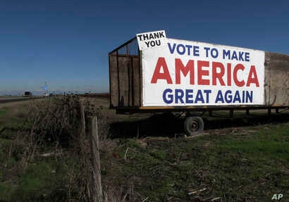 A Trump campaign sign is displayed near Los Banos, California, Dec. 16, 2016. A local farmer says Donald Trump's campaign vow to deport immigrants who are in the country illegally pushed him to buy more equipment, cutting the number of workers he'l...