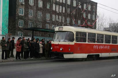 In this Feb. 2, 2019 photo, people queue up to board a tram in Pyongyang. North Korea is upgrading its overcrowded mass transit system in a campaign meant to show leader Kim Jong Un is raising the country's standard of living.