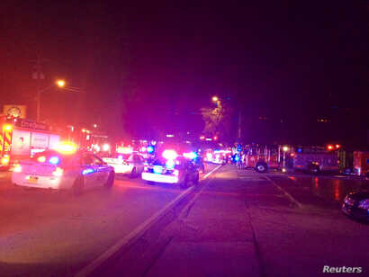Police cars and fire trucks are seen outside the Pulse night club where police said a suspected gunman left multiple people dead and injured in Orlando, Florida, June 12, 2016.