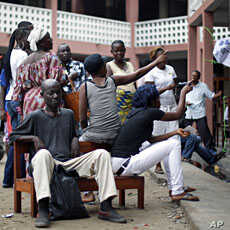 Voters wait for election material to arrive at a polling station in Kinshasa, Congo, November 28, 2011