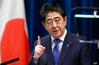 Japan's Prime Minister Shinzo Abe speaks during a press conference at the prime minister's official residence in Tokyo, Sept. 25, 2017.