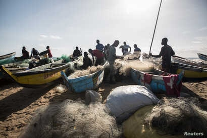 Fishermen gather close to the shore in West Point township, Monrovia, Liberia, May 30, 2018.