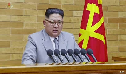 In this image made from video released by KRT on Jan. 1, 2018,  North Korean leader Kim Jong Un delivers his annual address from an undisclosed location in North Korea.