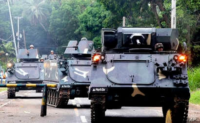 Tanks arrive at a military camp to reinforce government troops who are battling Muslim militants who laid siege in Marawi city for more than a week, May 31, 2017, in southern Philippines. Fighting continues for the second week with casualties on both...