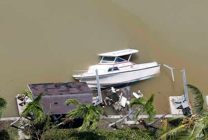 A boat is partially submerged in a canal in the wake of Hurricane Irma, Sept. 11, 2017, in Key Largo, Florida.