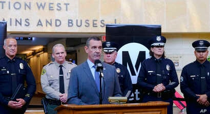 Transportation Security Administration (TSA) administrator David P. Pekoske, center, talks during a news conference in Los Angeles' Union Station, Aug. 14, 2018.