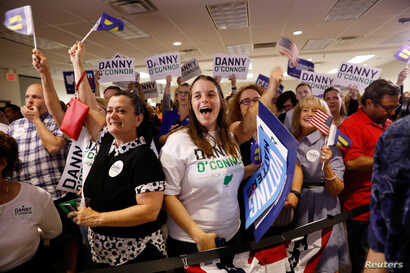 Supporters cheer as results come in for Democratic candidate Danny O'Connor in a special congressional election in Ohio's 12th district, at the election night party in Westerville, Ohio, Aug. 7, 2018.