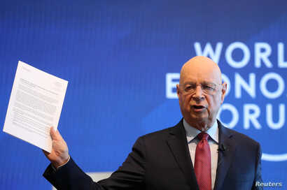 Klaus Schwab, Founder and Executive Chairman of the World Economic Forum holds the meeting's manifesto as he addresses a news conference ahead of the Davos annual meeting in Cologny near Geneva, Jan. 15, 2019.