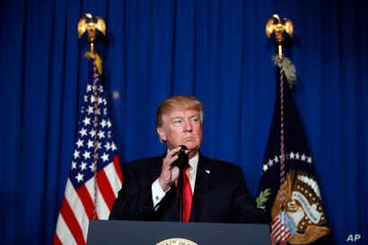 President Donald Trump speaks after the U.S. fired a barrage of cruise missiles into Syria Thursday night in retaliation for this week's gruesome chemical weapons attack against civilians, at Mar-a-Lago in Palm Beach, Fla., April 6, 2017.