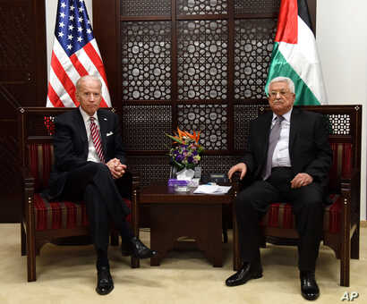 US Vice President Joe Biden, left, and Palestinian President Mahmoud Abbas, meet at the presidential compound in Ramallah, West Bank, March 9, 2016.