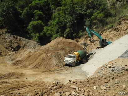 Roads are being widened in Bhutan both to cope with the tourist influx and for building new hydroelectric projects. (A. Pasricha/VOA)