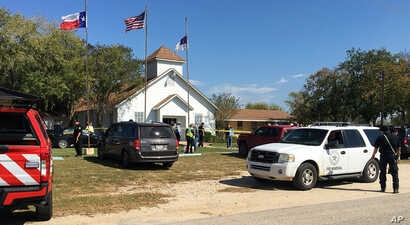 Emergency personnel respond to a fatal shooting at a Baptist church in Sutherland Springs, Texas, Nov. 5, 2017.