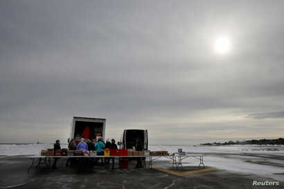 Volunteers and staff of Gather food pantry set up as they prepare to distribute produce, bread, eggs, milk and other supplies to members of the U.S. Coast Guard, who are working without pay during the government shutdown, and their families, at the U...