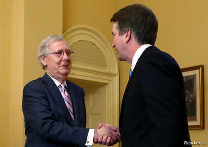 FILE - U.S. Senate Majority Leader Mitch McConnell greets Supreme Court nominee judge Brett Kavanaugh on Capitol Hill in Washington, July 10, 2018.