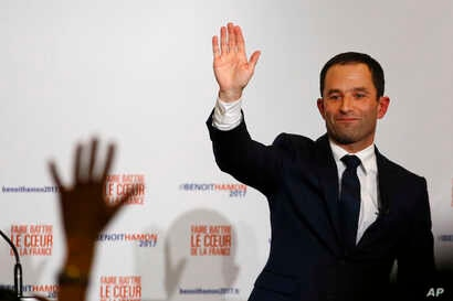 Benoit Hamon greets supporters after winning the socialist party presidential nomination in Paris, France, Sunday, Jan. 29, 2017.