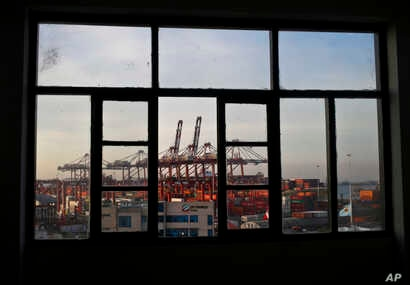 Cranes of the port of El Callao, Peru, are seen through a window, Nov. 17, 2016. Leaders of the Asia-Pacific Economic Cooperation will meet in Lima Nov. 19-20 to discuss the future of international trade policies, growth and improvement of life cond...