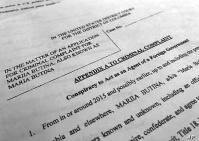 Court papers unsealed, July 16, 2018, photographed in Washington, shows part of the criminal complaint against Maria Butina.