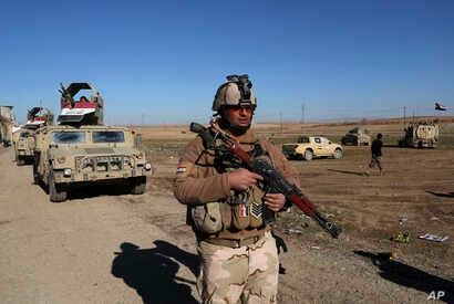 Iraqi Army soldiers deploy after defeating Islamic State militants in the eastern side of Mosul, Iraq, Tuesday, Jan. 24, 2017.